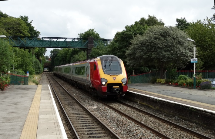 A Virgin Voyager diverted from the West Coast Main Line  passes Frodsham on 2 Aug 2015